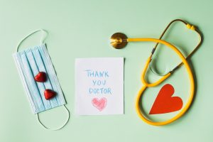 thank-you-doctor-note-next-to-a-face-mask-and-a-stethoscope