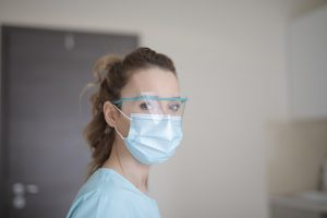 woman-in-blue-shirt-wearing-face-mask